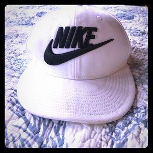 Nike white hat.